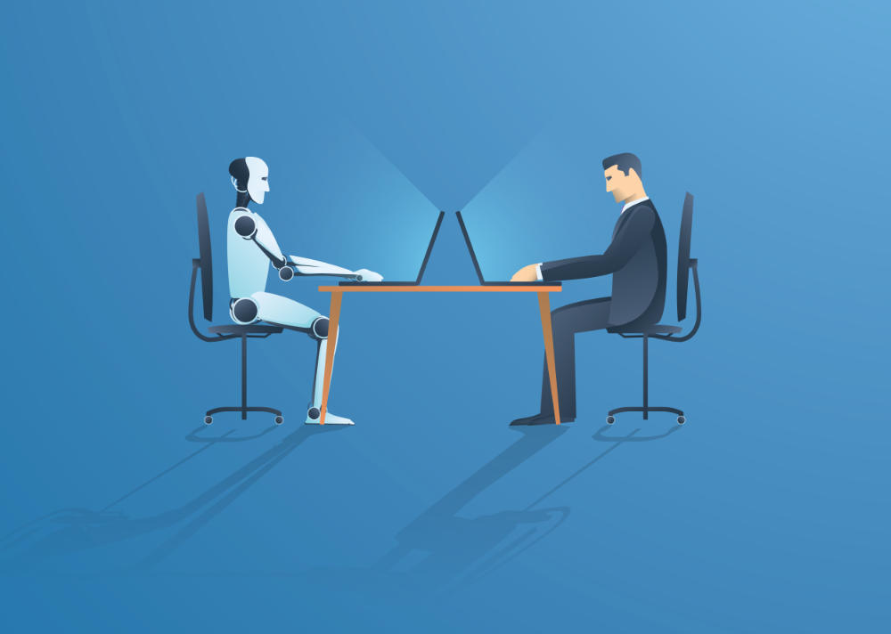 a robot and adult sitting across from each other learning about robotics on computers